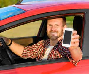 Uber Ruch Driver Poses with Smartphone in Hand