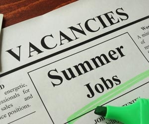 Ad in newspaper for summer job opportunities that's been highlighted