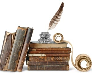 Historical books and quill for writing on white background
