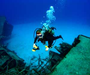 Salvage Diver Reviewing Sunken Ship