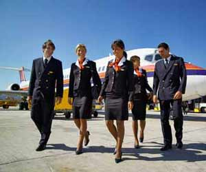 Airline Flight Attendants walking from Airplane to Terminal