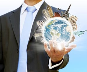 Man in suit holding the world in the palm of his hand