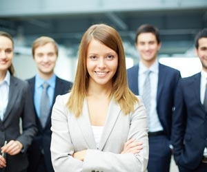 Female leader standing in front of the job search competition